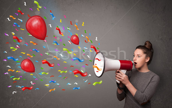 Young girl having fun, shouting into megaphone with balloons  Stock photo © ra2studio