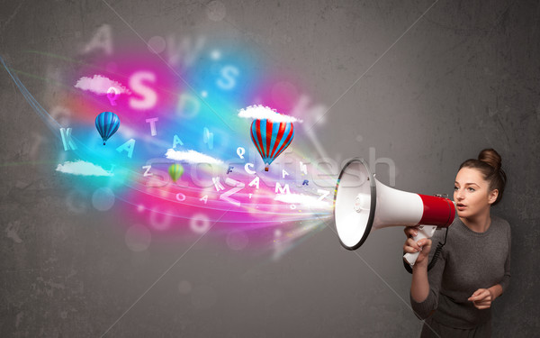 Stock photo: Girl shouting into megaphone and abstract text and balloons come