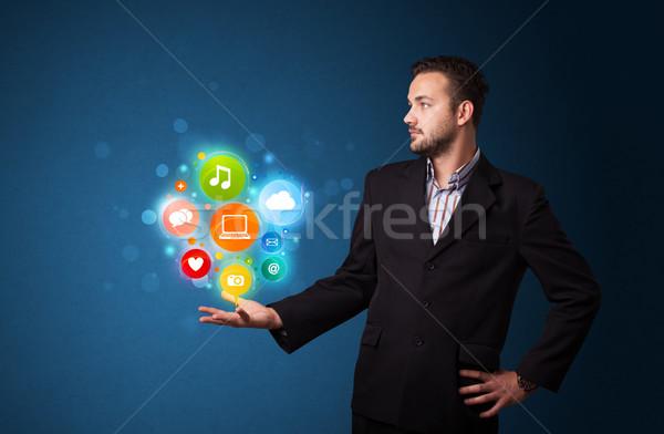 マルチメディア アイコン 手 ビジネスマン 小さな ストックフォト © ra2studio