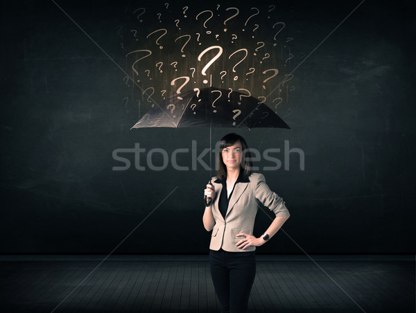 Businesswoman with umbrella and a lot of drawn question marks Stock photo © ra2studio