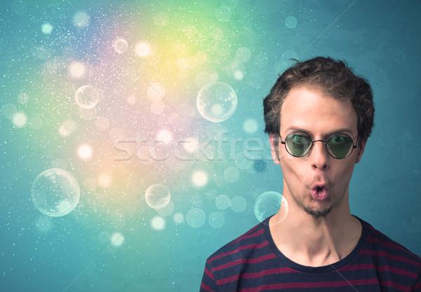 Stok fotoğraf: Genç · güneş · gözlüğü · bokeh · renkli · ışıklar · adam