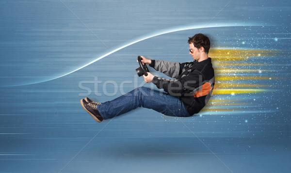 Giovane guida immaginario veloce auto offuscata Foto d'archivio © ra2studio