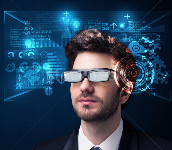 Young man looking with futuristic smart high tech glasses  Stock photo © ra2studio