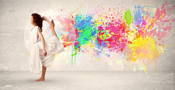 Mutlu genç atlama renkli mürekkep sıçramak Stok fotoğraf © ra2studio