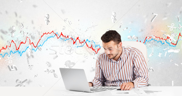 Business man sitting at table with stock market graph  Stock photo © ra2studio