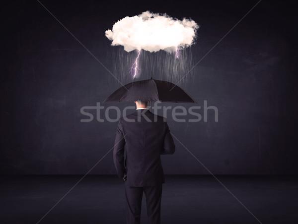 Biznesmen stałego parasol mały burzy Chmura Zdjęcia stock © ra2studio