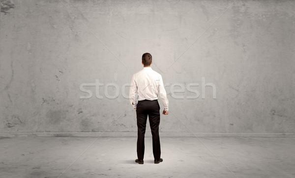 Businessman lost in empty urban space Stock photo © ra2studio