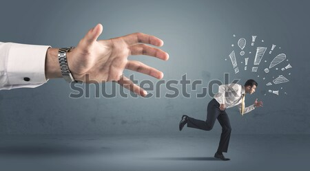 Business person getting away from a big hand Stock photo © ra2studio