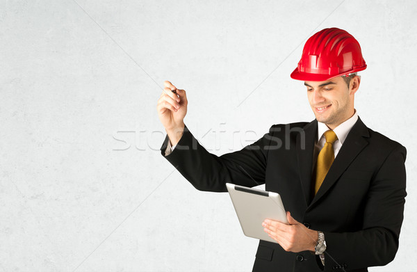 Young architect drawing in empty space Stock photo © ra2studio