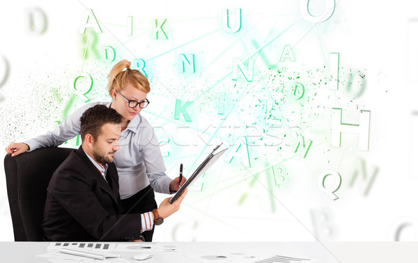 Business people at desk with green word cloud Stock photo © ra2studio
