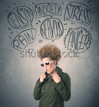 Mad young woman with extreme haisrtyle and speech bubbles Stock photo © ra2studio