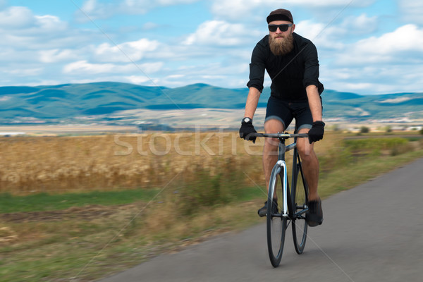 Természetes fiatal kerékpáros elképesztő kilátás elegáns Stock fotó © ra2studio