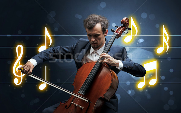 Young cellist with music sheet Stock photo © ra2studio