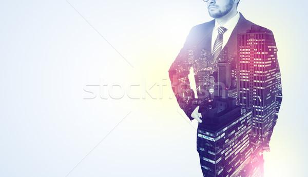Businessman standing with night city graphic Stock photo © ra2studio