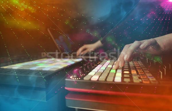 Kéz zene buli klub színek körül Stock fotó © ra2studio