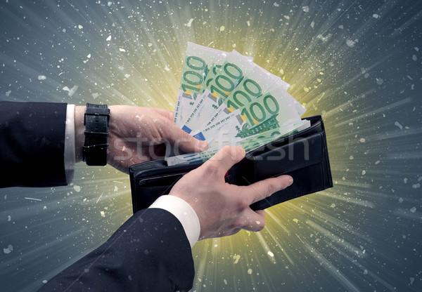 üzletember Euro pénztárca kéz ki dollár Stock fotó © ra2studio