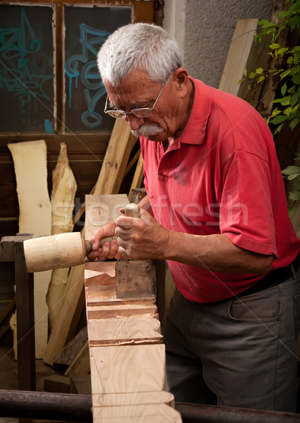 woodcarver working with mallet and chisel 3 Stock photo © ra2studio