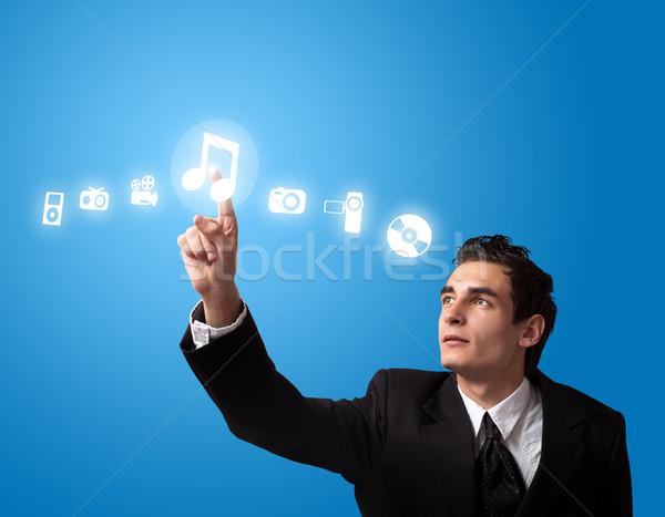 человека кнопки деловой человек музыку Сток-фото © ra2studio