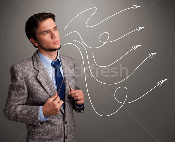 Attractive man looking at multiple curly arrows Stock photo © ra2studio