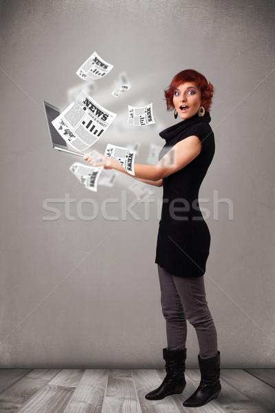 Casual pretty young woman holdin notebook and reading the explosive news Stock photo © ra2studio