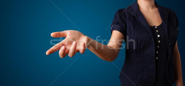 Femme imaginaire bouton jeune femme main Photo stock © ra2studio