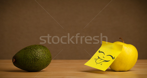 Apple with post-it note sticking out tongue to avocado Stock photo © ra2studio