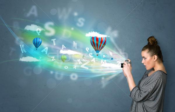 Fotografo fotocamera abstract immaginario cute ragazza Foto d'archivio © ra2studio