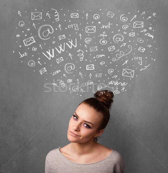 Jeune femme pense réseau social icônes au-dessus tête Photo stock © ra2studio