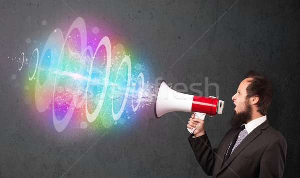 Homme haut-parleur coloré énergie poutre sur Photo stock © ra2studio