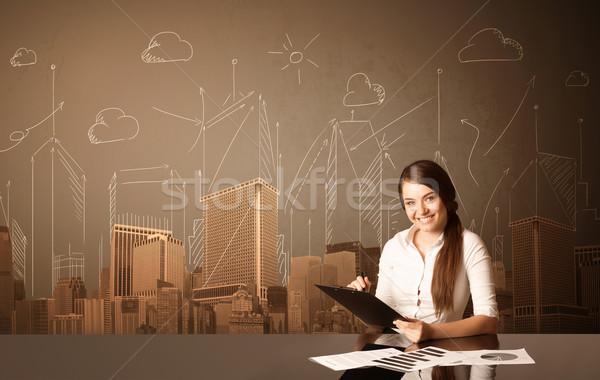 üzletasszony épületek ül fekete asztal papír Stock fotó © ra2studio