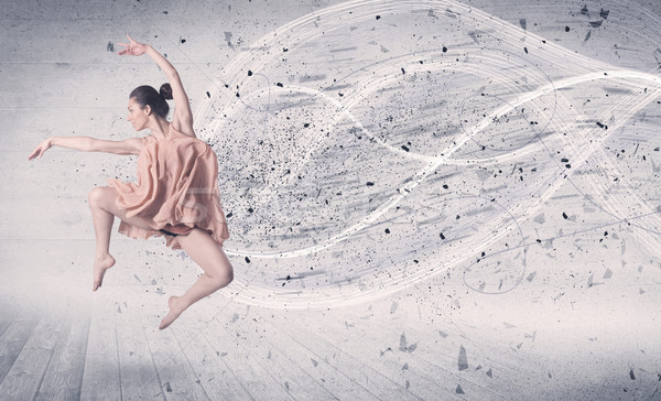 Performance ballet dancer jumping with energy explosion particle Stock photo © ra2studio