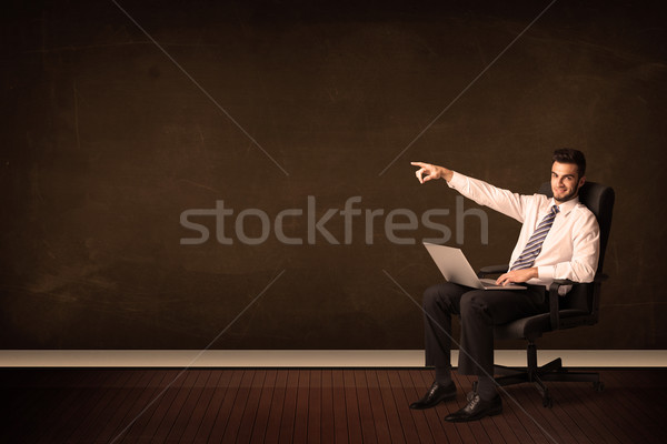Businessman holding high tech laptop on background with copyspac Stock photo © ra2studio