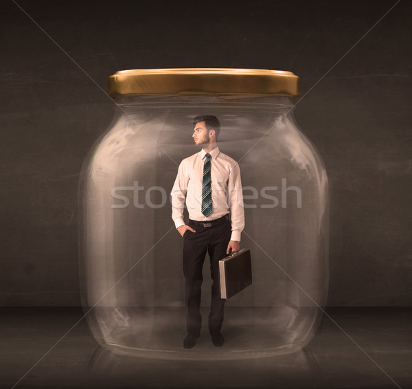 Stock photo: Businessman shut into a glass jar concept
