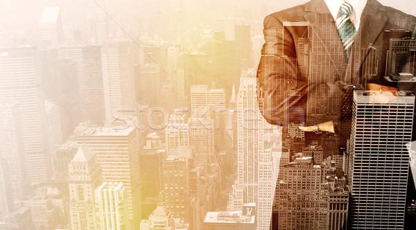 Homem de negócios olhando cidade quente escritório feliz Foto stock © ra2studio