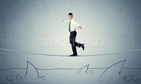 бизнесмен ходьбе веревку Сток-фото © ra2studio