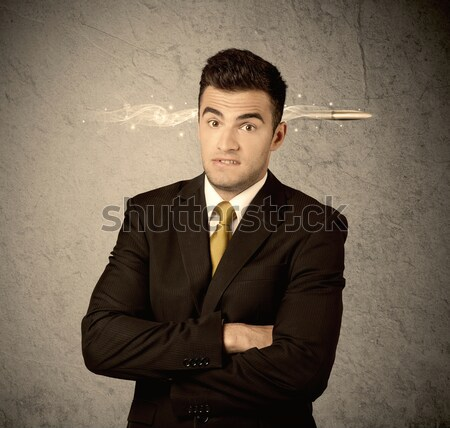 Fast creative sales guy with smoking bullet Stock photo © ra2studio