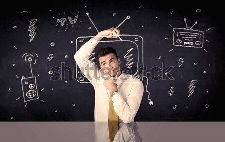 Happy businessman drawing tv and radio Stock photo © ra2studio