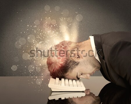Stock photo: Angry businessman with lights and keyboard