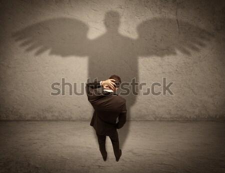Stockfoto: Eerlijk · verkoper · engel · schaduw · geslaagd · zakenman