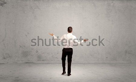 Running businessman with device in hand Stock photo © ra2studio
