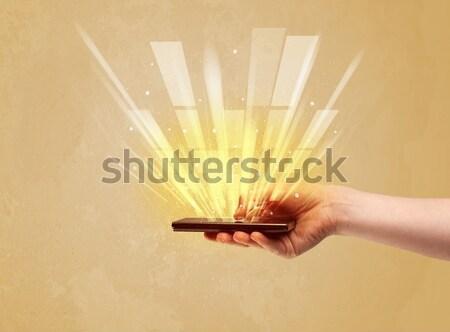 Mano telefono giallo luce Foto d'archivio © ra2studio