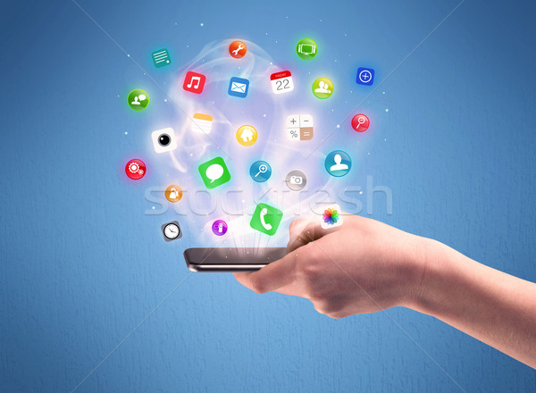 Hand holding tablet phone with app icons Stock photo © ra2studio