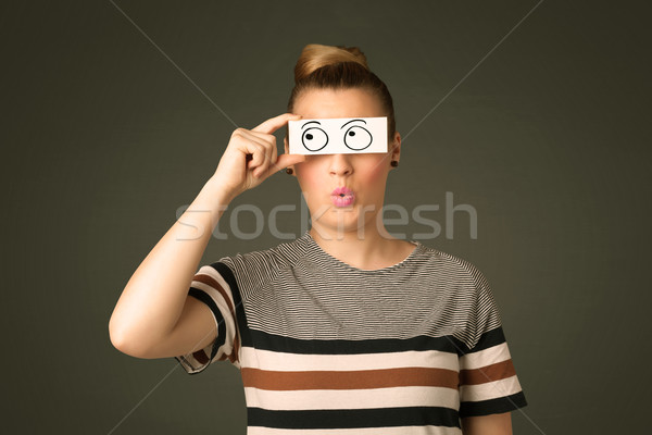 Stock photo: Young silly girl looking with hand drawn eye balls on paper