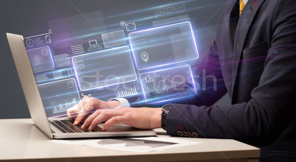 Hand typing on laptop with online finance management concept Stock photo © ra2studio
