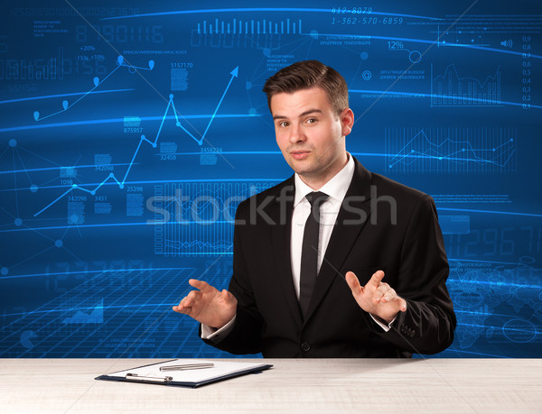 Stock data analyst in studio giving adivce on blue chart background Stock photo © ra2studio