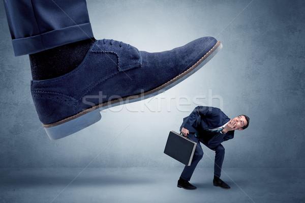 Cruel jefe empleado grande pie pequeño Foto stock © ra2studio
