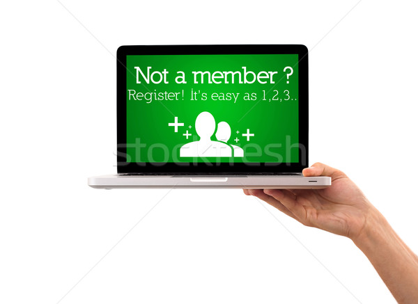 Hand holding laptop with register sign Stock photo © ra2studio