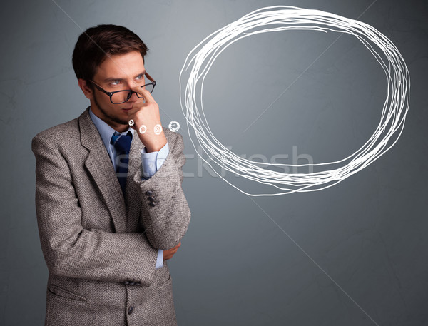 Stock photo: Good-looking young man thinking about speech or thought bubble