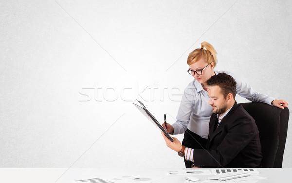 Businessman and businesswoman with plain white copy space Stock photo © ra2studio