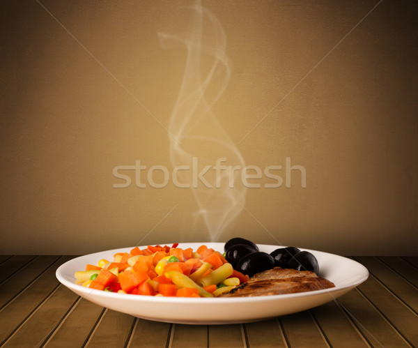 Fresh delicious home cooked food with steam Stock photo © ra2studio